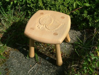 Child's stool in lime with carved lime leaves